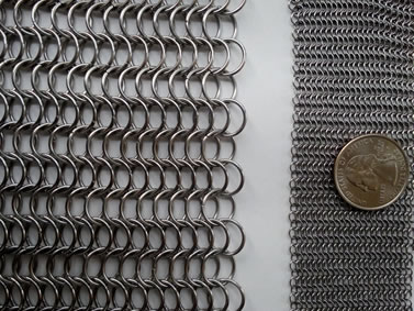Two pieces of chainmail rings: the left is made of big rings and the right is made of small rings with a coin on it.