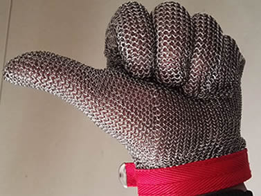 A hand wearing a silver white chainmail glove is making a gesture of great.