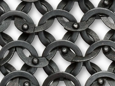 Many pieces of black flattened metal rings are connected together.
