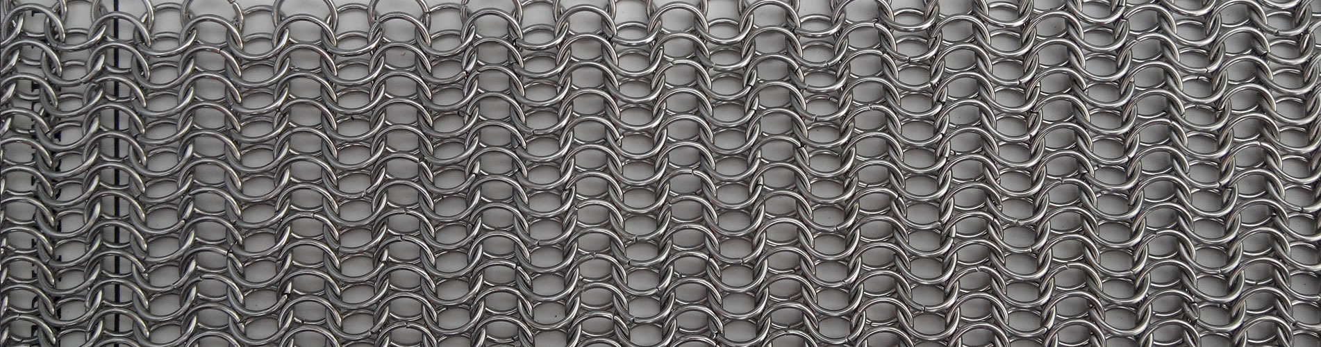 A piece of stainless steel butted round chainmail.