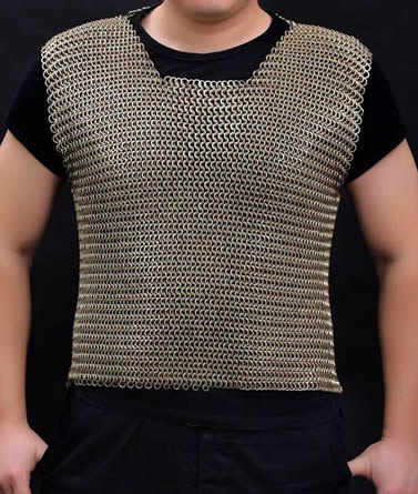 A person is wearing a piece of stainless steel chainmail shirt without sleeves.