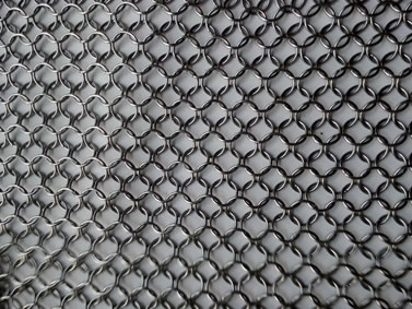 A piece of silver white chainmail armor in stretching state.