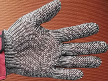 A stainless steel five-finger style chainmail glove with pink flexible wrist strap.