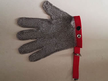 A stainless steel chainmail golve with red fasten strap and metal buckle towards left.